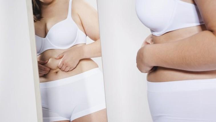Zakaj se je tako težko znebiti maščobe okoli pasu? (foto: Profimedia)